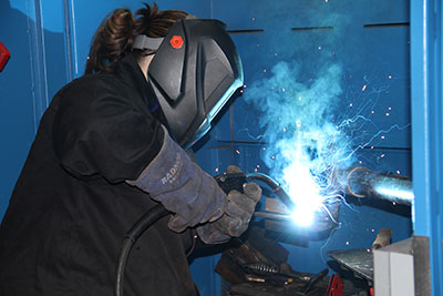 Student welding in the welding lab
