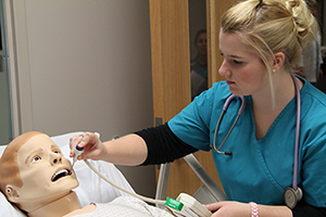 Nursing student working in the simulation lab