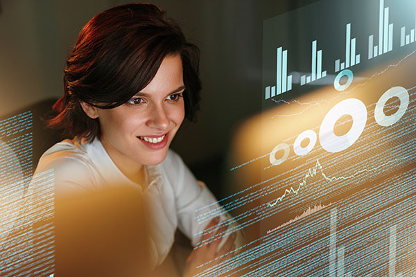 Female business woman viewing business statistics on a computer screen