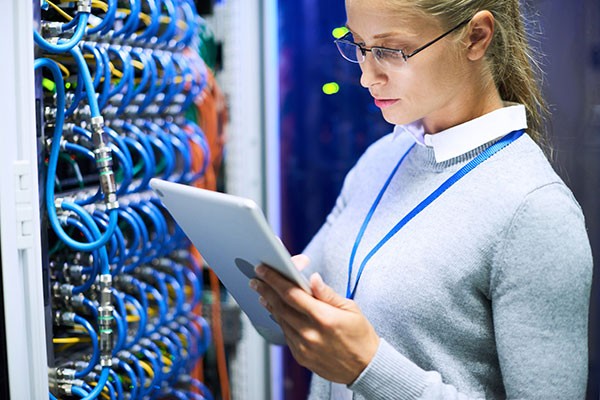 Woman working with a super computer