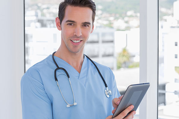 Male doctor holding a digital tablet
