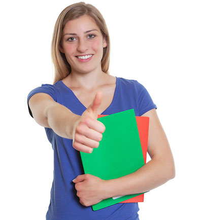 Female student giving the thumbs up