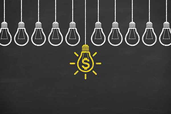 Finance idea bulb on blackboard