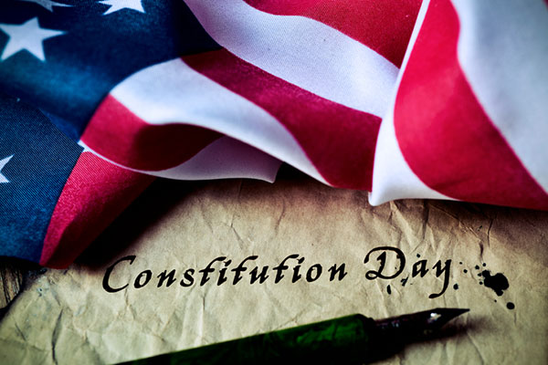 American flag with the words Constitution Day written below