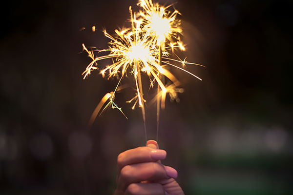 Close-up of a hand holding a sparkler