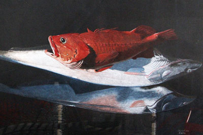 Painting of a red fish on a table