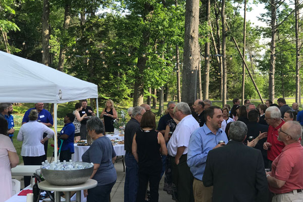 A group of people at outside at the Bay College West Business After Hours event