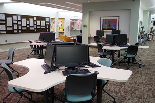 Online Learning department with computer stations located in the HUB on the campus of Bay College