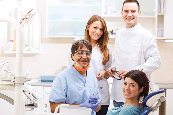 Dentist and assistants working on a patient